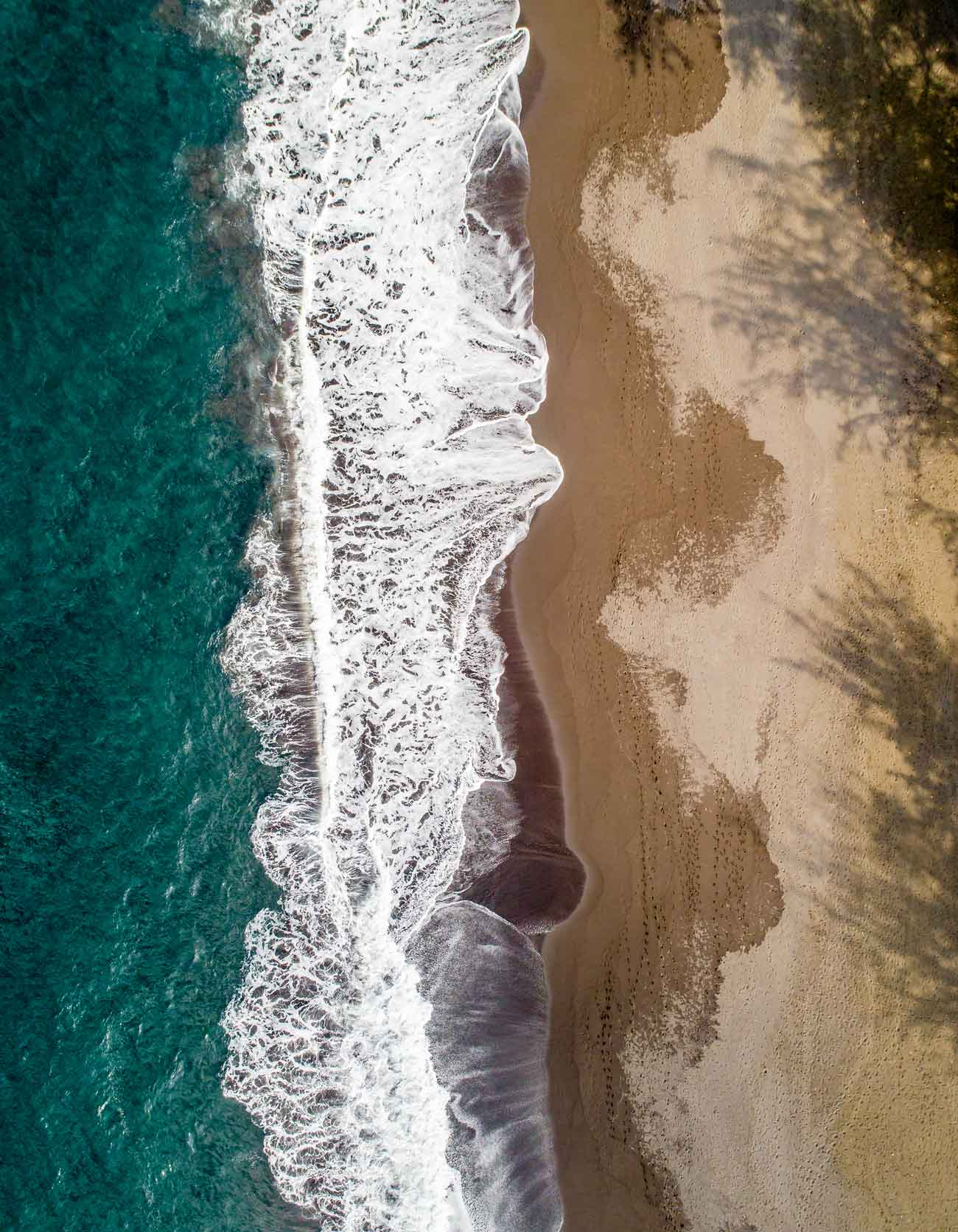 Bird's eye view of a beautiful beach in hawaii by drone'