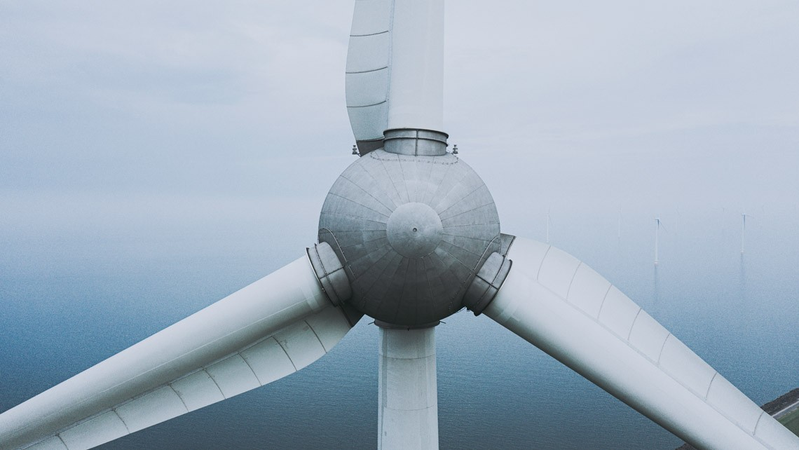 close up aerial view of a wind turbine inspection by drone