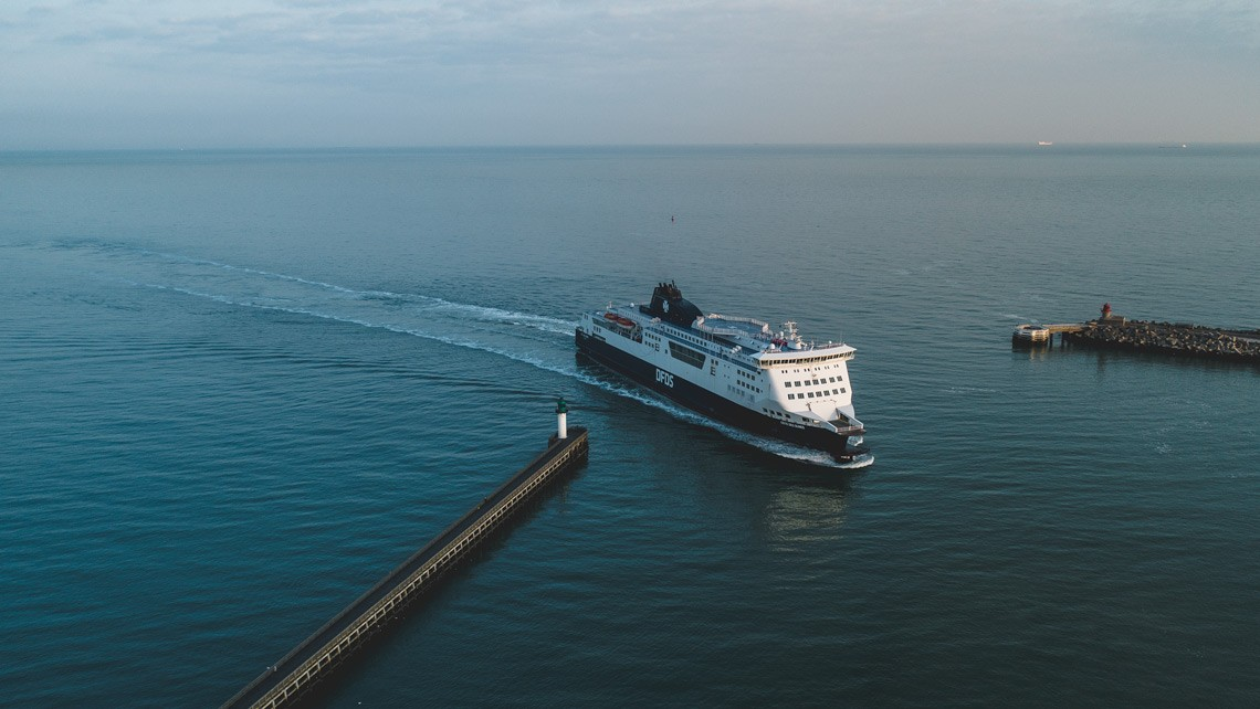 a ferry arriving into port aerial drone photo