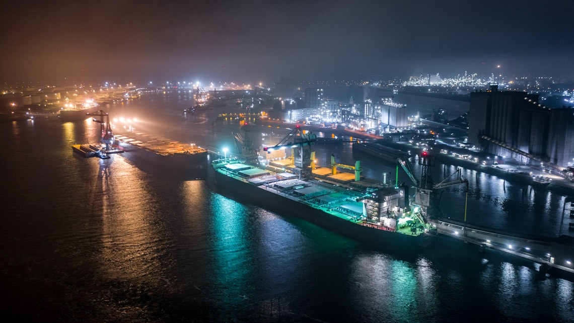 a container ship at night photographed by drone