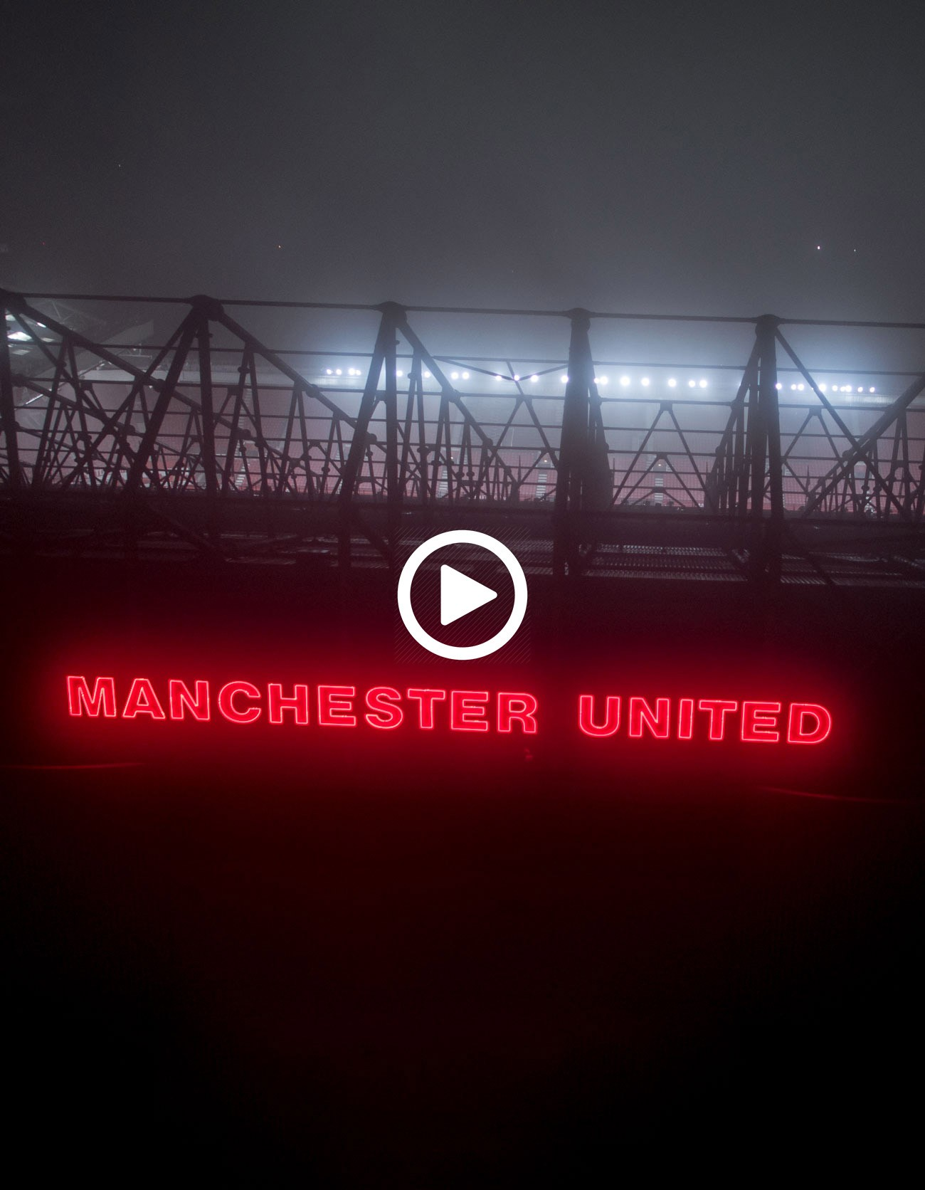 Manchester United stadium at night drone photo