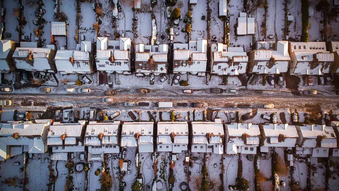 houses photographed by drone in a city