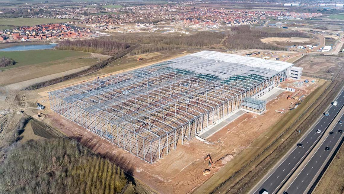 aerial photo of a warehouse in construction