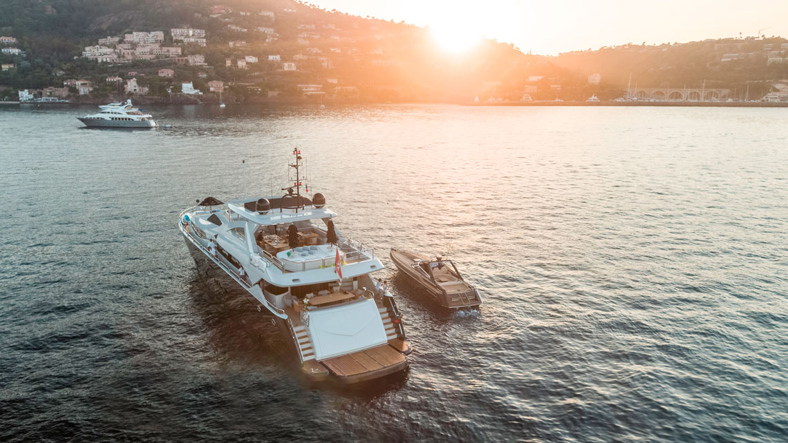 super yacht moored up in the early evening photographed from the air by a drone